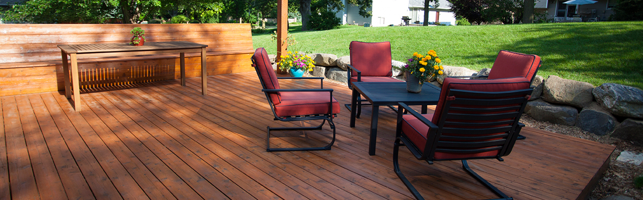 Wooden Deck with Wooden Bench, Wooden Table, and Patio Set